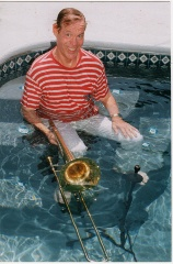 Roy Wiegand in the pool with his trombone